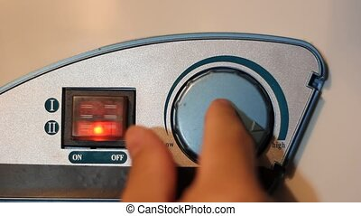 Water temperature controls on a hot water heater, twist...