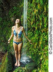 Woman underwaterfall in Hawaii