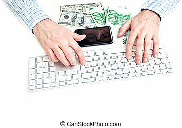 Making money - Man is typing on computer keyboard, some euro...