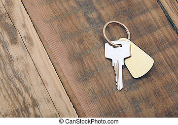 silver key with blank tag