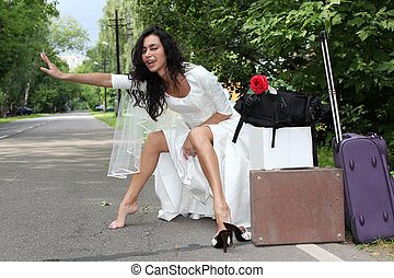 beautiful bride hitch-hike at the road
