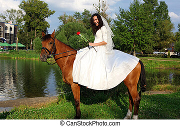 Bride horseback at brown horse