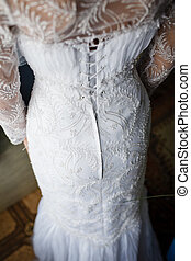 Image of back of bride in wedding dress