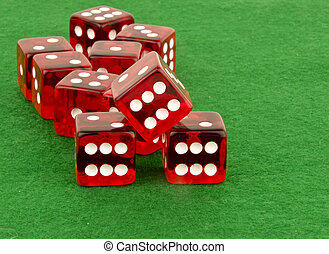 red poker dice on green table - multiple red dice on green...
