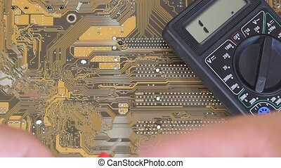 Man measures multimer motherboard