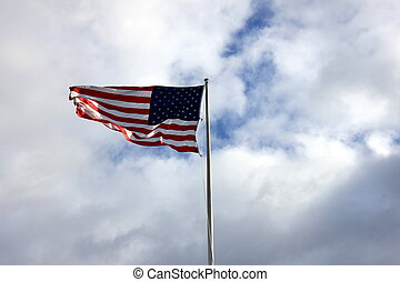 Flag waving in brisk breezes - American flag on display,...