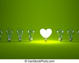 Heart shaped light bulb on green background
