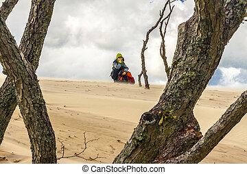 Tourist on the dunes - Leba, Poland.