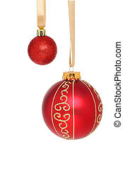 Red Baubles - Large and small red Christmas baubles hanging...