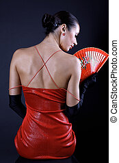 back latino woman with red fan and black glove