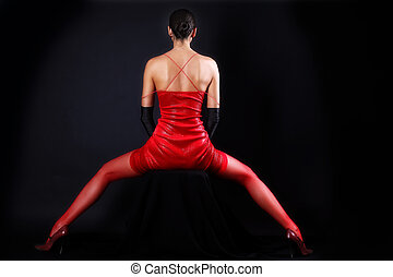 back woman in red outfit