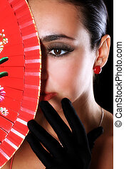 latino woman with red fan and black glove