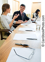 Communication - Portrait of business partners sitting in...