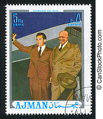 Eisenhower and Nixon - AJMAN - CIRCA 1976: stamp printed by...