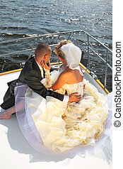 Happy bride and groom on a luxury yacht. - Happy...