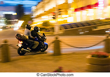 Night motorcyclist - Man and woman on motorcycle at night...