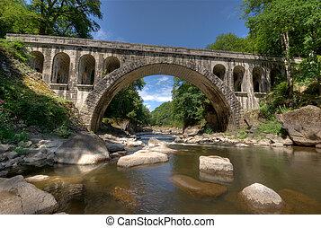 old bridge - Ancient stone bridge over a small trout river