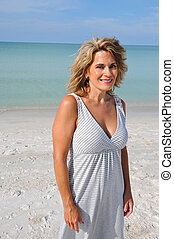 Middle Age Woman on Beach - Portrait of Middle Age Woman...