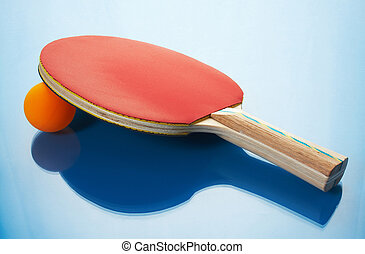 Tennis racket and orange ball on a blue background