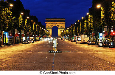 The Champs-Elysees at night in Paris, France