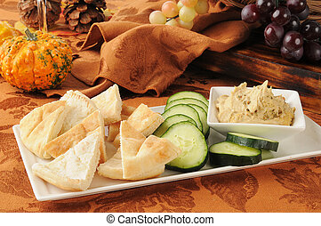 Hummus with pita bread and cucumber - Garlic spice hummus...