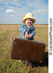 lonely girl with suitcase - Young beautiful girl with...