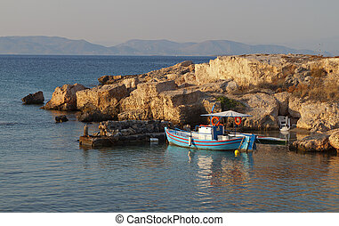 Aigina island in Greece - Scenic port and fishing boat at...