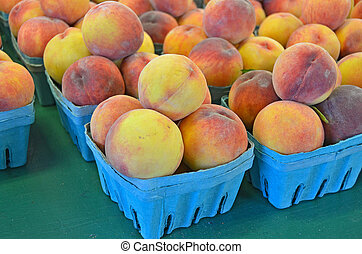 fresh picked peaches - Fresh peaches in produce boxes.