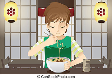 Boy eating noodle