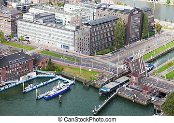 barge passes through a lock on the channel in Rotterdam,...