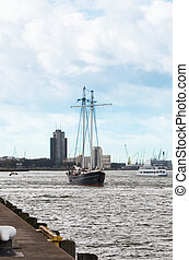 yacht goes down the river Maas in Rotterdam, Holland