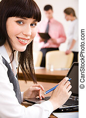 Woman at work - Close-up of young smiling businesswoman...