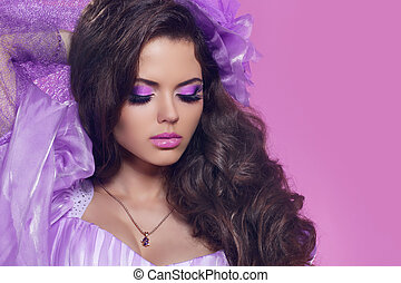 Beautiful woman with curly hair and bright make-up Jewelry...