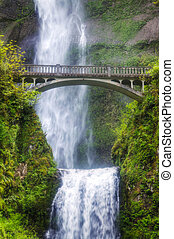 Multnomah falls and bridge in the morning sun light -...