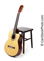guitar and stool - brown wooden stool and a six string...