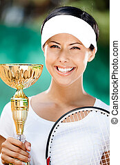 Young female tennis player won the cup - Tennis player won...