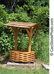 Wishing Well - Wishing well constructed of small blocks of...