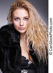 beautiful fashionable woman in black fur
