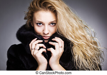 beautiful fashionable woman in black fur