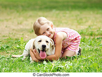 little girl with her dog - A little blond girl with her pet...
