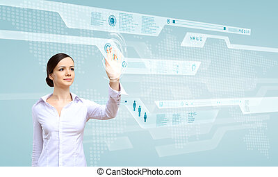 Businesswoman and touch screen technology - Young woman in...