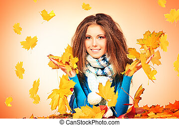 leafage - Beautiful smiling girl in an autumn leaves.
