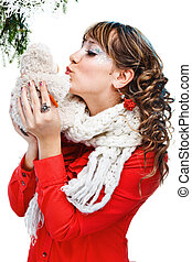 beautiful woman in warm clothing with toy