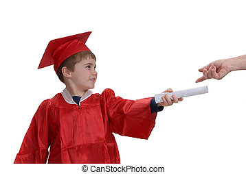 Receiving Diploma - Young boy in cap and gown holding his...