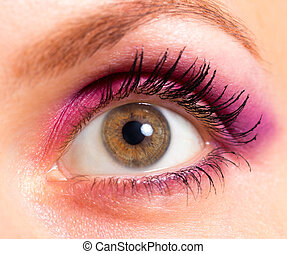 Brown eye with bright pink and violet makeup
