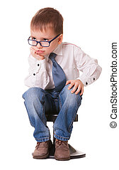 Serious young genius - Serious clever kid in jeans and shirt...