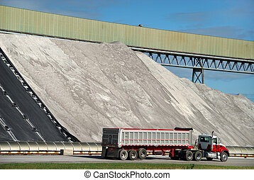 Salt Pile - Semi truck ready to be loaded with salt from...