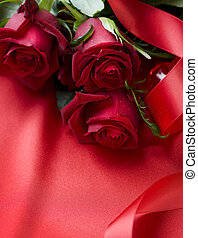 Red Roses bouquet over silk background
