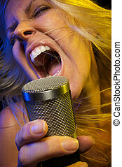 Woman Singer Rocks Out - Woman with Microphone Sings with...