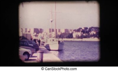 Vintage 8mm. Docked sail boat
